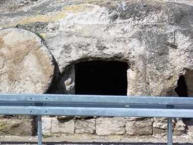 Here's an actual tomb with a rolling stone next to the entrance. I took this photo on the side of a highway in Galilee.