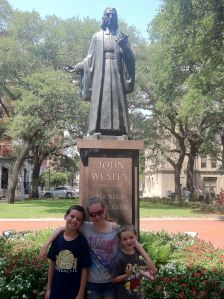 This Methodist preacher's kids at the Wesley statue in Reynolds Square in Savannah in 2011.