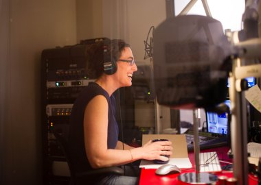 "Reporter Sarah Koenig, producing a new episode of the ""Serial"" podcast."