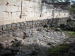 Darker rocks beneath 4th-century synagogue belong to the synagogue of Jesus' day.