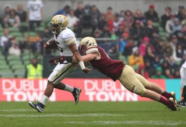 A Boston College defender tries to tackle Justin Thomas. As if!