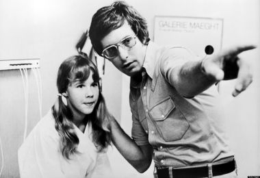 Actress Linda Blair and director William Friedkin on the set of <em>The Exorcist</em> in 1974.